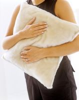 Woman holding cushion