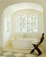 Bath in alcove in classic bathroom