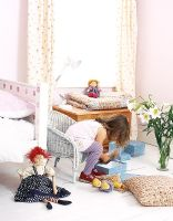Little girl playing in classic bedroom