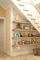 Display of items on under stair shelving