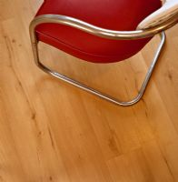 Detail of dining chair on wooden floor