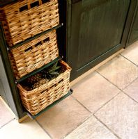 Detail of basket drawers in classic kitchen
