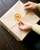 Detail of someone wrapping a Christmas present