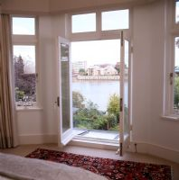 Open french windows with river views