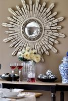 Sunburst mirror on dining room wall