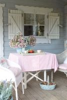 Garden table and chairs on summerhouse porch