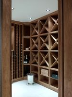 Wooden shelves in modern wine cellar