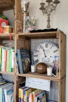 Distressed clock and books on bookcase