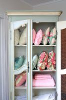 Vintage cabinet full of cushions and fabrics