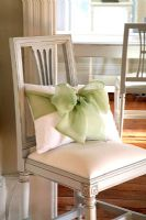 Cushion with large bow on classic chair