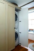 Washing machine and dryer in cupboard