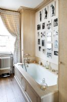 Classic bathroom with feature wall of photos