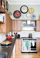 Display of wall clocks in classic kitchen