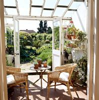 Garden furniture in classic conservatory