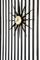 Clock and stripy wallpaper