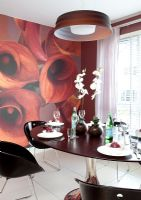 Modern black, red and white dining room with feature wall