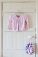 Clothes hanging on white door