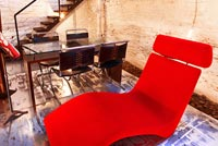 Red chaise lounge in dining room