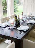 Contemporary dining table set for Christmas meal