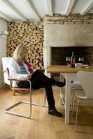 Maria Stendgaard-Green relaxing in her dining room