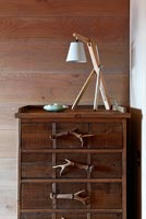 Wooden chest of drawers with antler handles