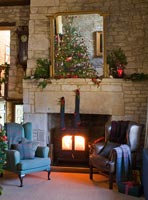 Cotswold stone fireplace decorated for Christmas