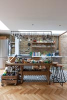 Open plan kitchen with salvaged furniture