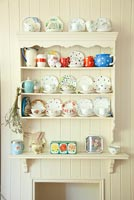 Crockery display on wooden shelves