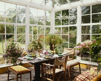 Classic conservatory with table set for meal