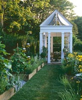 Country garden with raised beds and gazebo