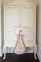 Cream armoire with Christmas advent angel