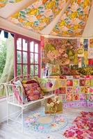 Inside of shed decorated by Kaffe Fassett with needlepoint designs at RHS Chelsea Flower Show 2012