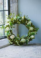 Christmas wreath of Mistletoe, Ivy and Roses
