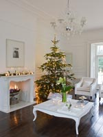 White living room decorated for christmas