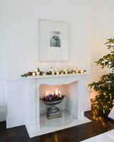 Decorative marble fireplace decorated for christmas