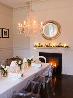 White dining room decorated for christmas