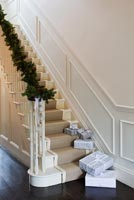 Classic hallway with christmas pine and cone garland