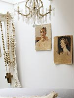 Portraits on white wall