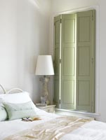 Classic bedroom with green shutters