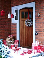 Front door with christmas presents