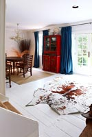 Cowhide rug on dining room floor