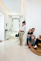 Sandrine and Herve and family in their hallway