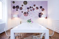 Contemporary white dining room with epoxy painted table