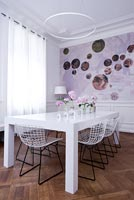 Contemporary white dining room with epoxy painted table and Bertoia chairs