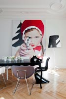 Contemporary dining room with 'Little Red Riding Hood Aiming Revolver' photo by Sandra Seckinger