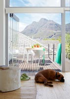 View through patio doors to roof terrace and mountains