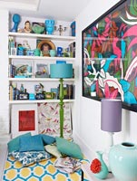 Colourful display of accessories on living room shelves