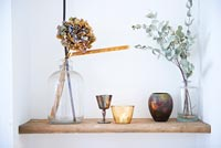Dried Hydrangea flower and Eucalyptus foliage in vintage  bottles