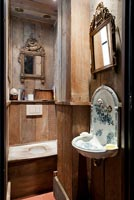 Bathroom with reclaimed wooden panelling