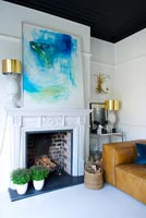 Classic fireplace with abstract painting